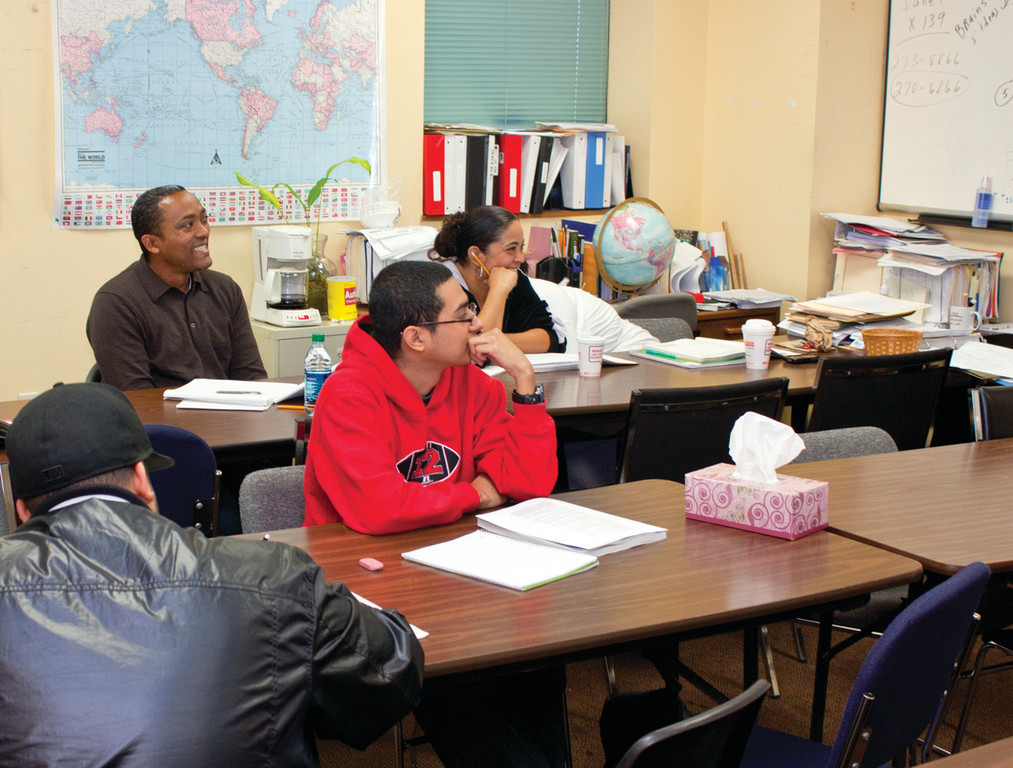 ALWAYS LEARNING: Jesus Castro (left) is getting the training he needs to find a job and manage finances at Dorcas Place.