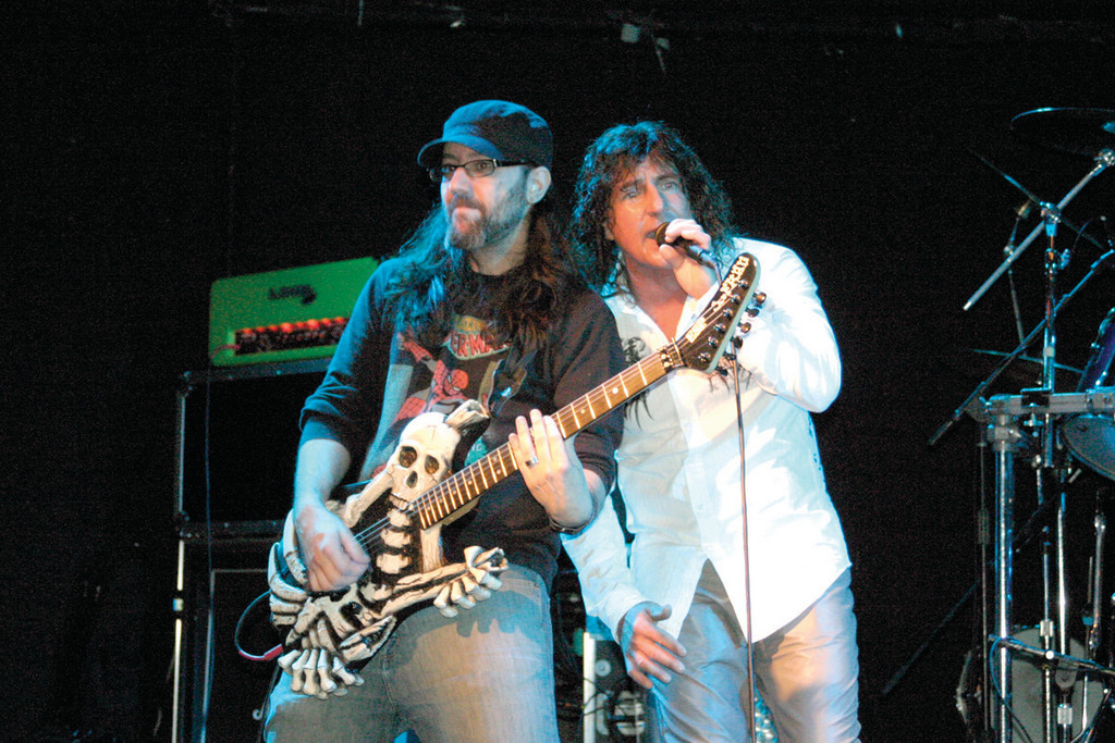ROCKIN� FOR A CAUSE: With his custom made ESP bones guitar, Dave Souza (left), along with vocalist Scott Korpela, are two members of Tooth and Nail, a tribute to the 1980s rock band, Dokken.