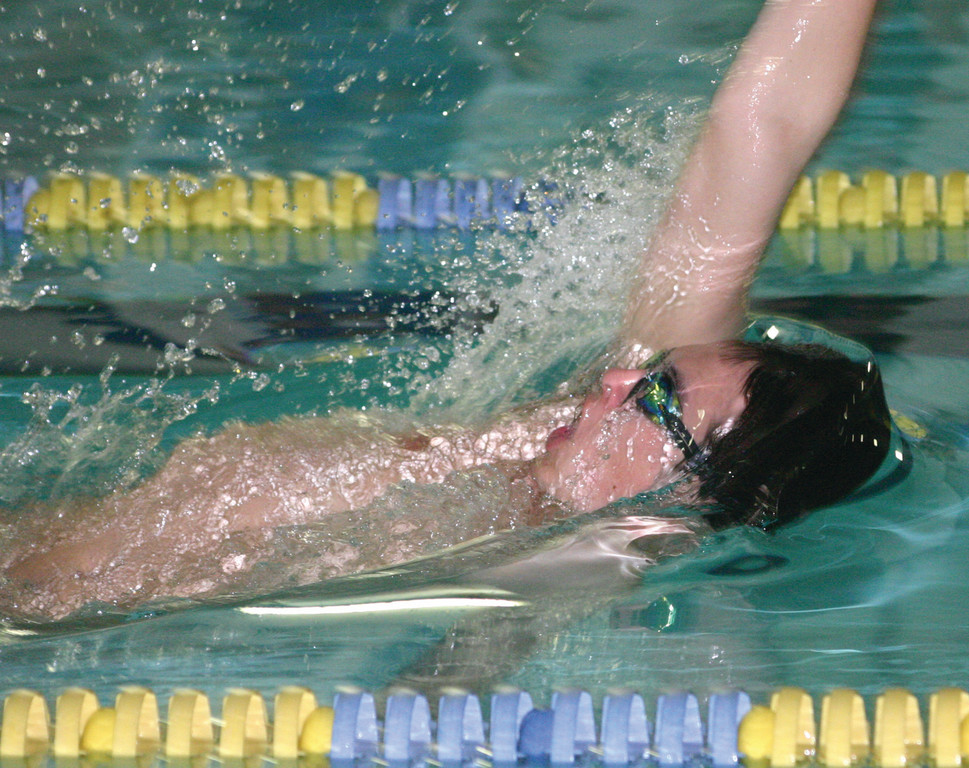 BACKING AWAY: Hendricken's Alex Powers does the backstroke during Tuesday's meet with Cumberland.