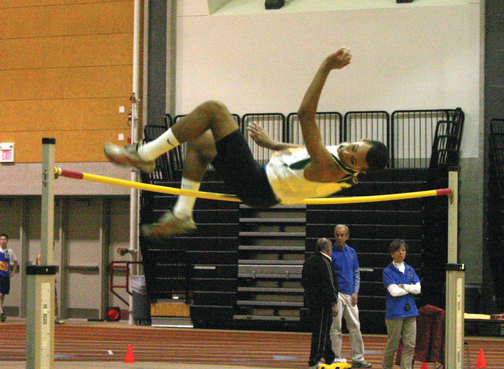 Hendricken's Jordan Barboza-Simpkins clears the bar in the high jump.