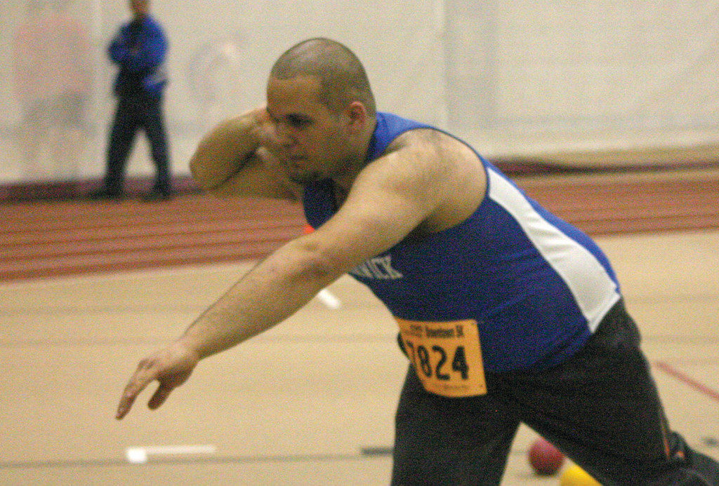 Vets' Joe Spaziano lines up a throw in the shot put.