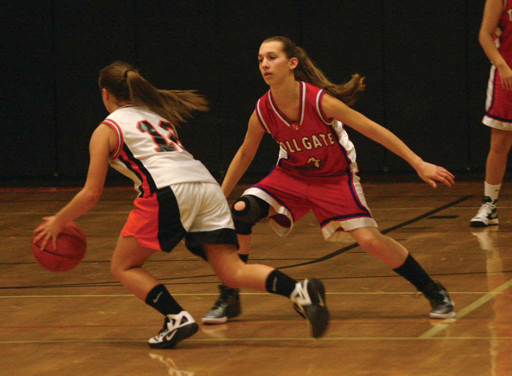 UP CLOSE: Toll Gate's Lauren Barnes (right) plays tight defense on a West Warwick player.