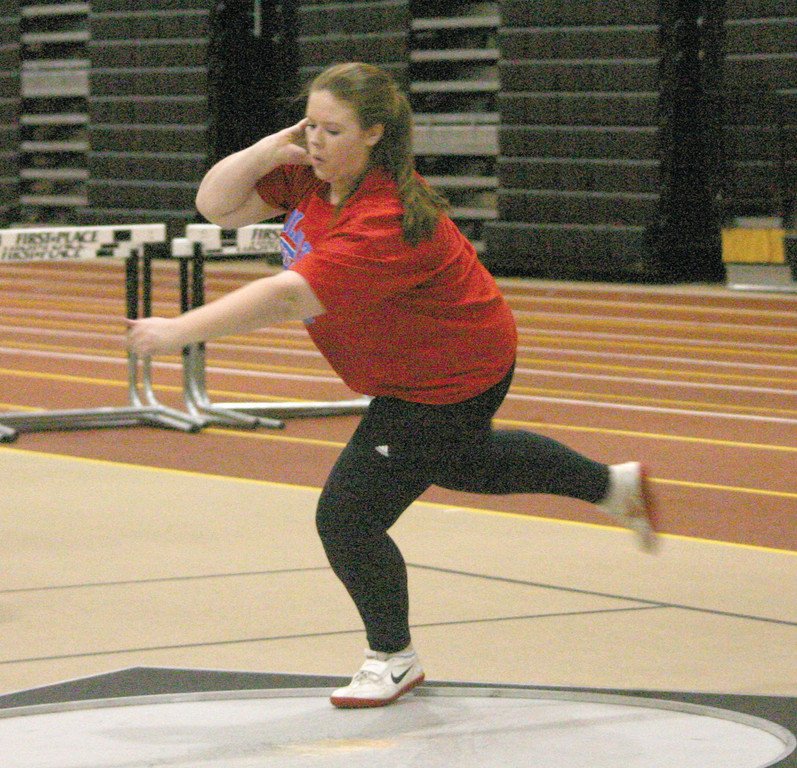 PRIMED AND READY: Toll Gate's Katie St. Amand competes in the shot put during last week's season-opening meet.