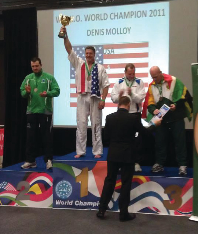 CELEBRATION: Warwick's Dennis Molloy salutes the crowd after winning a WAKO World Championship last month.