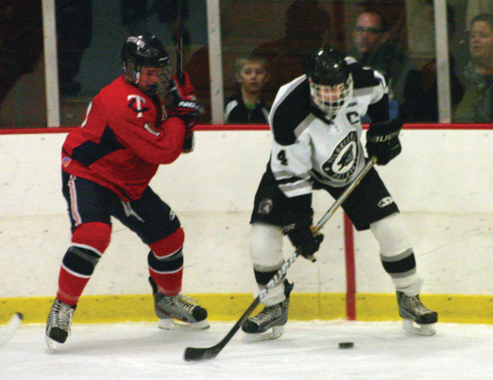 ON THE BOARDS: Toll Gate's Kyle Ellis (left) and Pilgrim's Dylan LaGarie battle for a loose puck during Saturday's game.