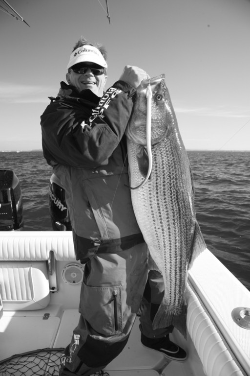 George Poveromo, all smiles after landing this 39-pound striped bass last week outside of Chesapeake Bay, will host the January 7, Salt Water Sportsman National Seminar Series at the Mohegan Sun Casino in Connecticut.  Poveromo is also the host of the VERSUS television series - George Poveromo's World of Saltwater Fishing.