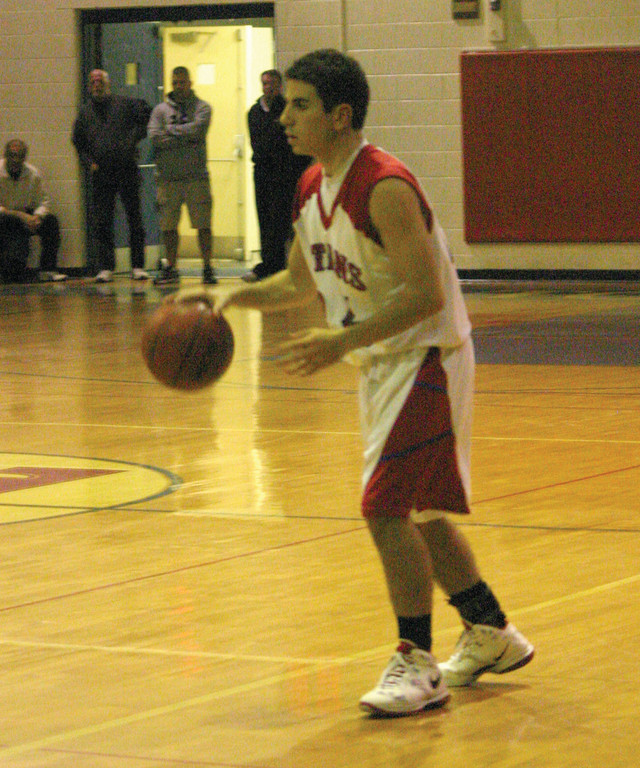 Austin Abramson dribbles the ball up the court.