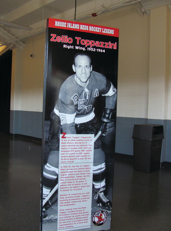 "TOPPER IS TOPS: The late and legendary Zelio ""Topper"" Toppazzini is pictured on this part of the section of the Rhode Island Reds Heritage Society's moveable exhibit inside the Dunkin' Donuts Center that's entitled, ""When the Reds Ruled the Roost."" Toppazzini, the Reds' ""Player of the Century,"" will be enshrined posthumously into the AHL Hall of Fame."
