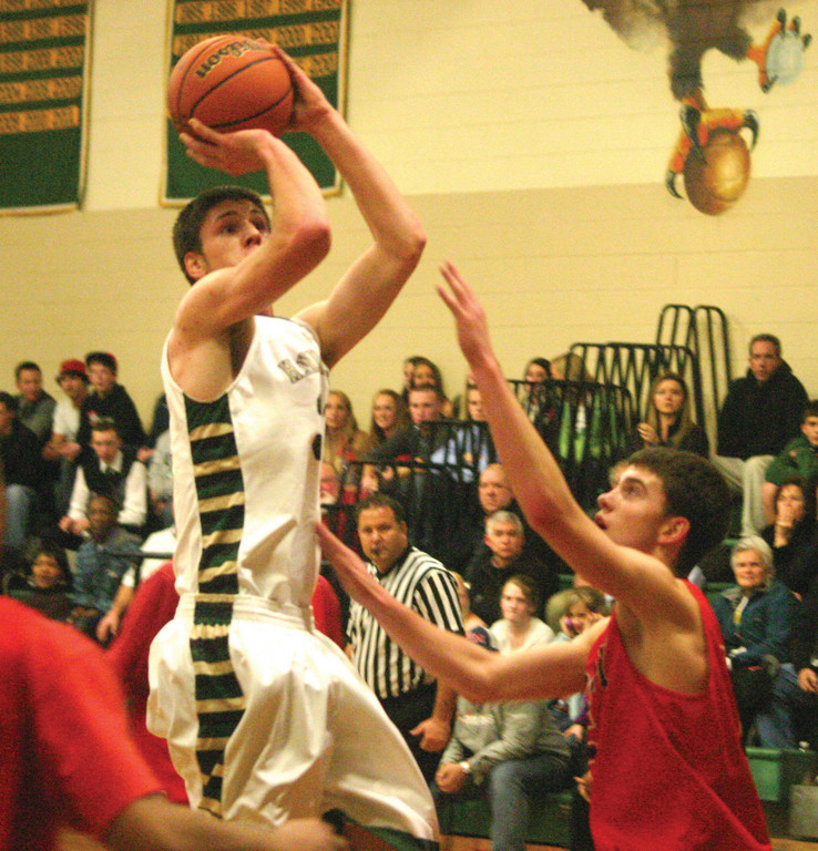 COMING THROUGH: Nick Bordeau puts up a jump shot in the paint on Tuesday night.