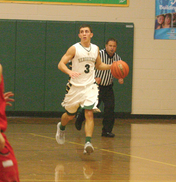 Point guard Corey Palumbo walks the ball up the court.