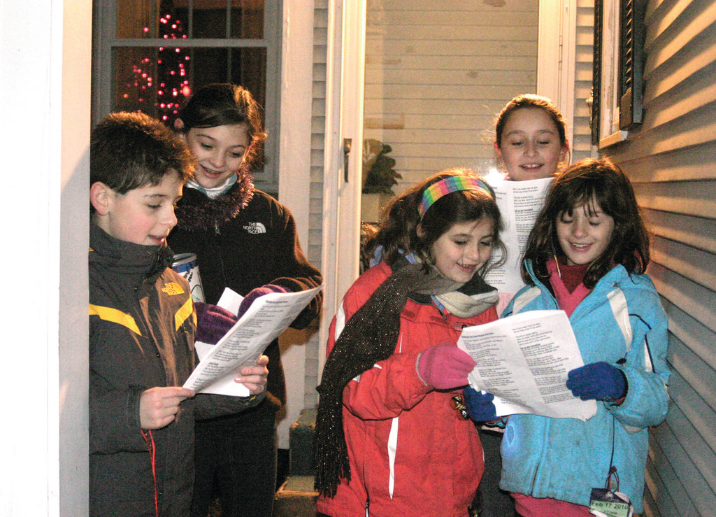 CHEERFUL CHILDREN: From left, Michael Ryan, 10, Shannon McCamish, 11, Meaghan McCamish, 8, Carina Cardi, 7, and Olivia Cardi, 10, enjoy Christmas caroling.