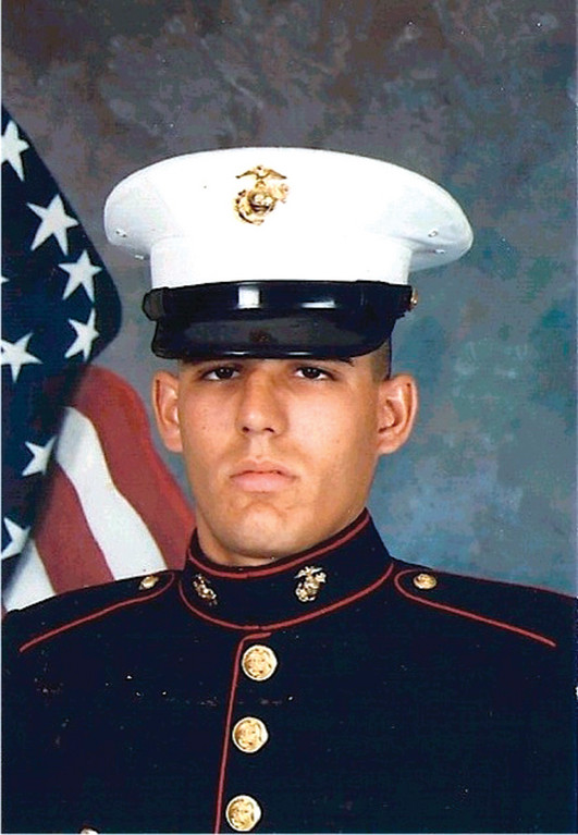 THEN: Robert Diaz in 1990, a 22-year-old Marine Corporal. Tracy Campbell was 8 years old, and in the second grade at Woonsocket Elementary School.