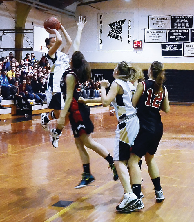 THE SHOT: Pilgrim's Danielle LeBlanc scored her 1,000th career point on this jump shot in Thursday's game. She became the sixth Pilgrim girls' player to join the 1,000-point club.
