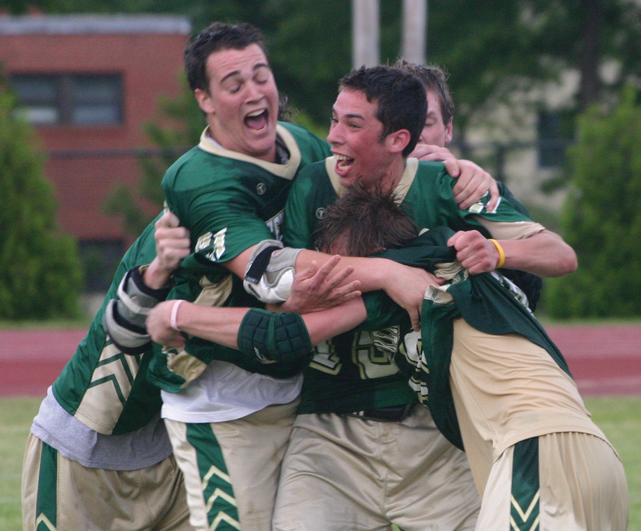 Hendricken celebrates its upset in the lacrosse finals.