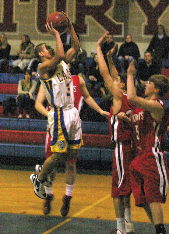 LEANING: Vets' Carter Thomas takes a tough shot in the lane in Tuesday's game.