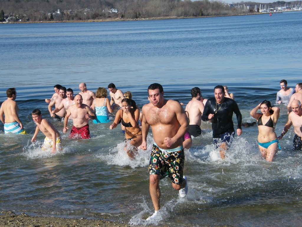 BRRRRR: Daring swimmers emerge from the water after taking a New Year's Day plunge at the Frozen Clam.