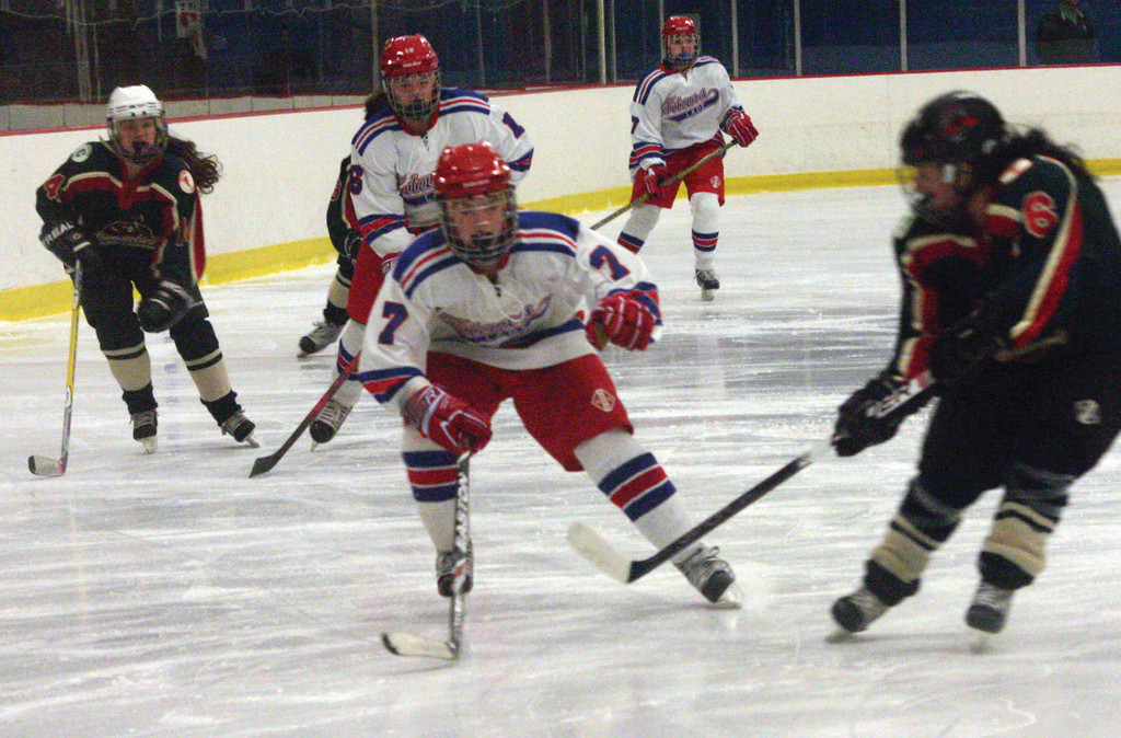 ON FIRE: Emily Fox chases after a loose puck during Friday's game. Fox had four goals and five assists in two weekend victories over Cranston. The wins moved Warwick to 5-2.