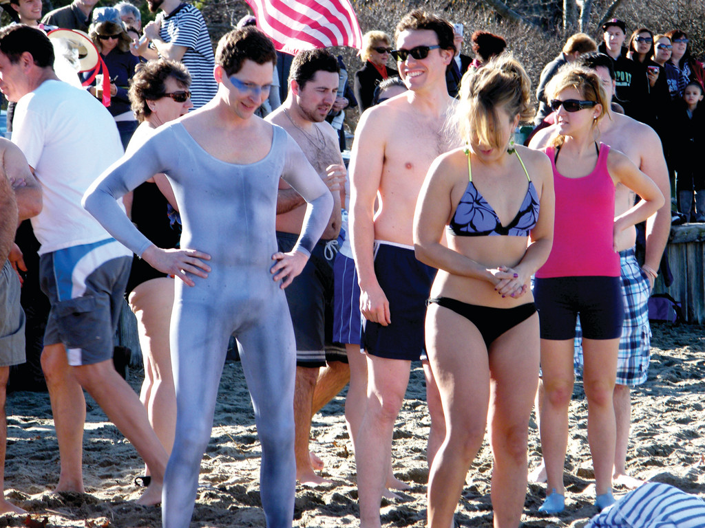 AT THE STRIKE OF NOON: More than 100 people took to the waters of Greenwich Bay New Year's Day to raise funds for nonprofits. Above, swimmers wait for the start of the Frozen Clam.