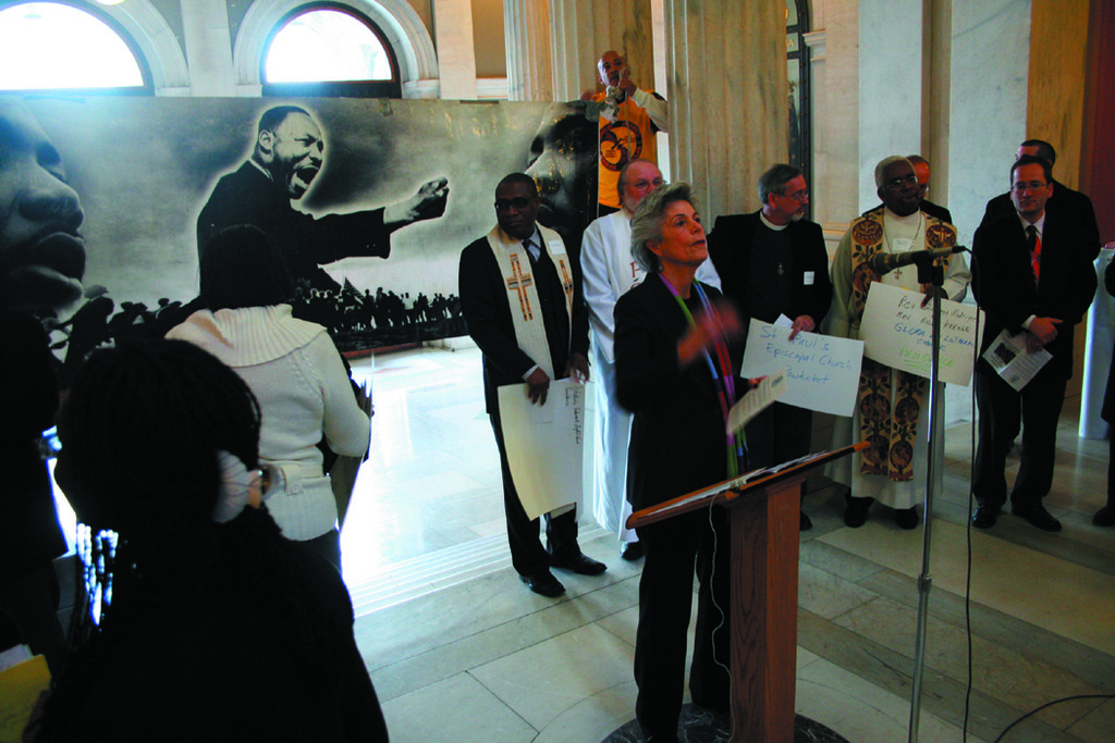 HOPEFUL PRAYER: Maxine Richman, co-chair of the Rhode Island Interfaith Coalition, addresses a crowd of spectators, including Senate President M. Theresa Paiva-Weed and Attorney General Peter Kilmartin, at a vigil on the steps of the Rotunda at the State House yesterday.