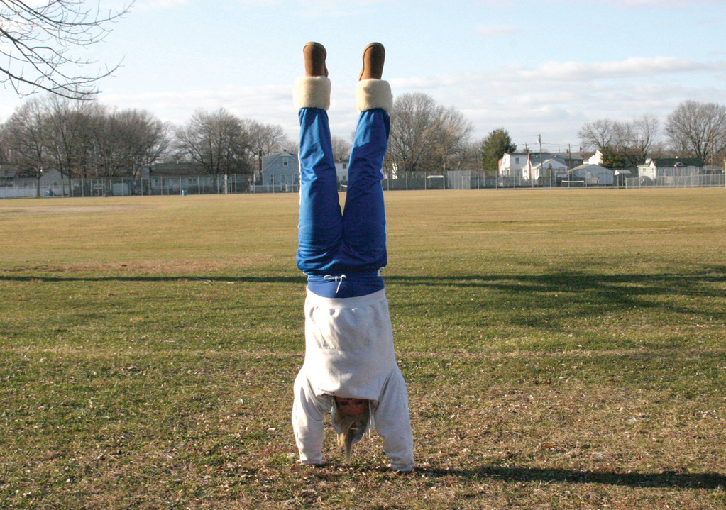 FLIPPING OUT: Haley Gould, 17, a senior at Warwick Veterans Memorial High School, said she can do 40 backhand springs consecutively and is thinking about attempting to become the new world record holder. As of July 2010, the world champion is Chelsey Kipping, who has completed 32 backhand springs in a row.