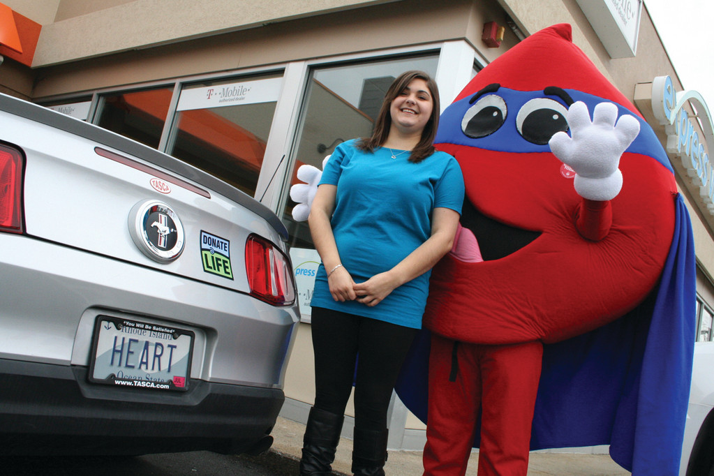 Allison Lindgren poses with Hemoglobin, the RI Blood Center mascot.