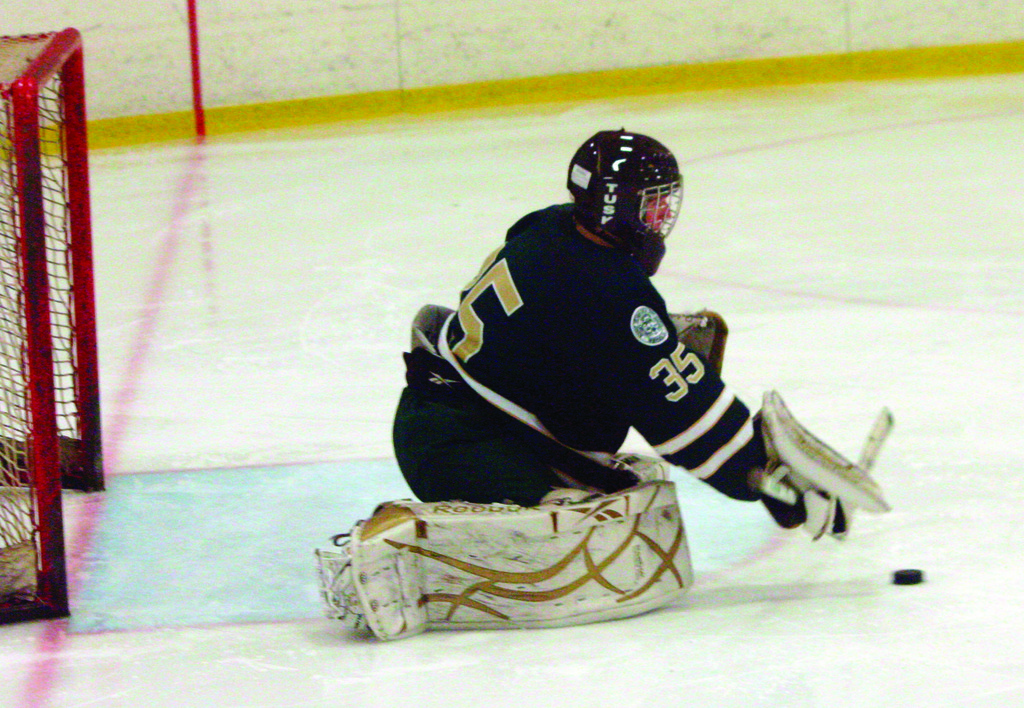 STOPPING IT: Hendricken goalie Mitch Proulx handles the puck in Saturday's game against Cranston West. Hendricken beat the Falcons and Mount St. Charles this weekend to run its league-best record to 7-0-1.
