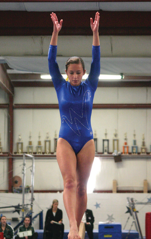 HANDS UP: Megan MacCrae competes on beam.
