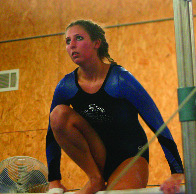 Katie Favino competes on bars.