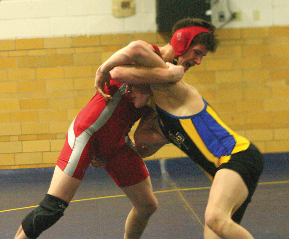 HANGING TOUGH: West's Serge Bouyssou wrestles North Providence's Mike Murphy in dual meet.