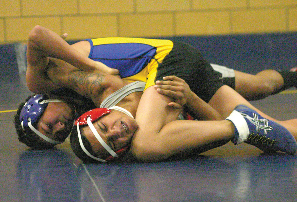 BREAK FREE: West's Rackwon Kisilywicz tries to escape the grasp of North Providence's Joe Jerez.