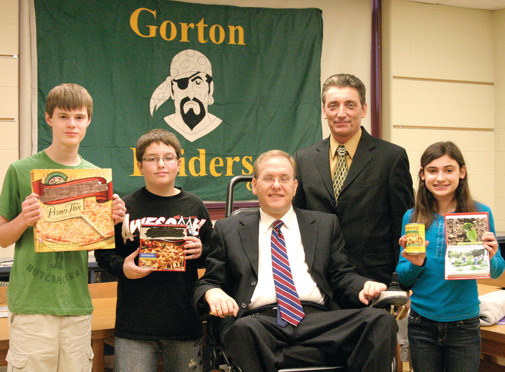 SLICE OF GOVERNMENT: Less than a month after they composed and mailed a letter to Congressman Jim Langevin about how they don't consider pizza is a vegetable, seventh and eighth grade students at Gorton Junior High School were visited by the Congressman to give him their take in the issue. Eighth graders and Student Council members Nate Genest, 13; Nick Kidd; and Julia French, 12, led the presentation with Langevin (center) and James Arena-DeRosa, the Northeast Regional Administrator for the United States Department of Agriculture.