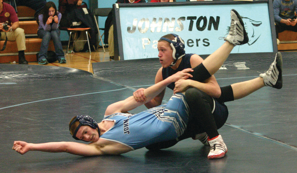 HOLDING STEADY: Toll Gate's Dave Navilliat tries to keep Johnston's Derric Vigeant on his back during their match at 152 on Monday night.