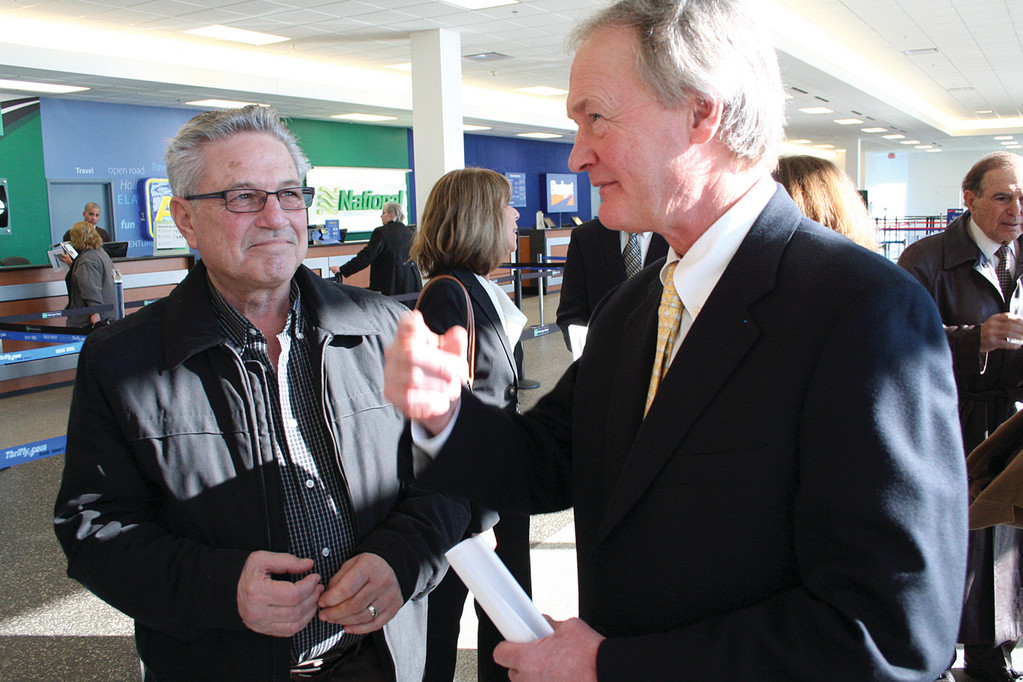 LOST IN THE INTERLINK: Gov. Chafee thought Joseph Piscopio had a good idea when he suggested a yellow brick road could help people get from the parking garage to the Interlink. Chafee said yellow paint would do the job.