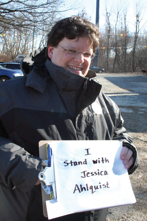 "IN SUPPORT OF JESSICA: Daniel Ciora displays one of several signs he made in support of ""my friend"" Jessica Alhquist."