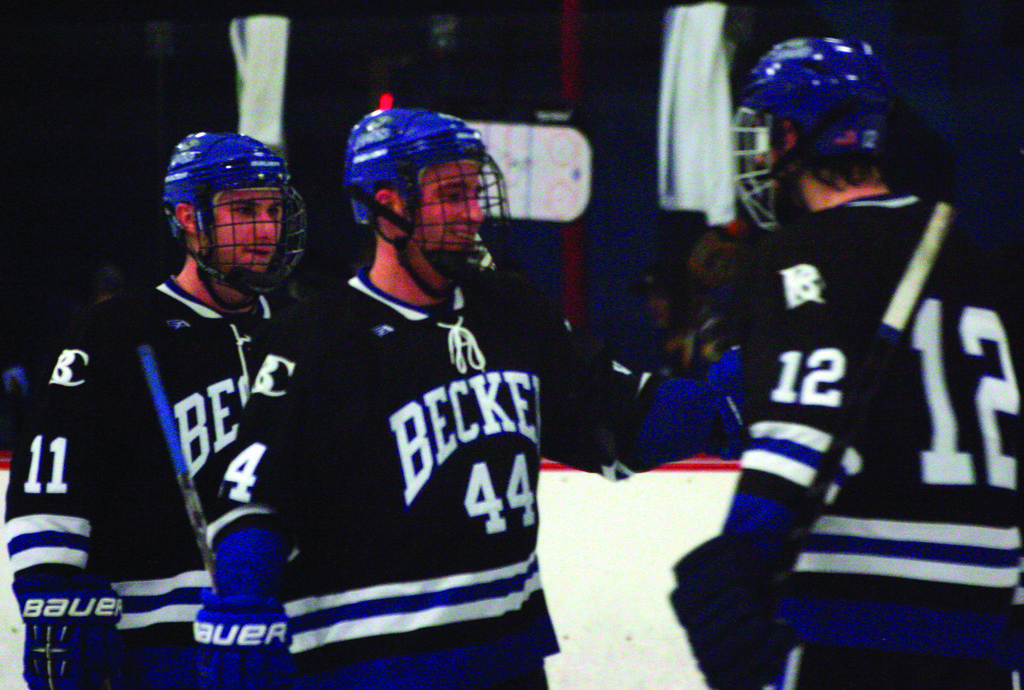 BIG FINISH: Bobby Gauthier celebrates Sunday's victory with his Becker College teammates.