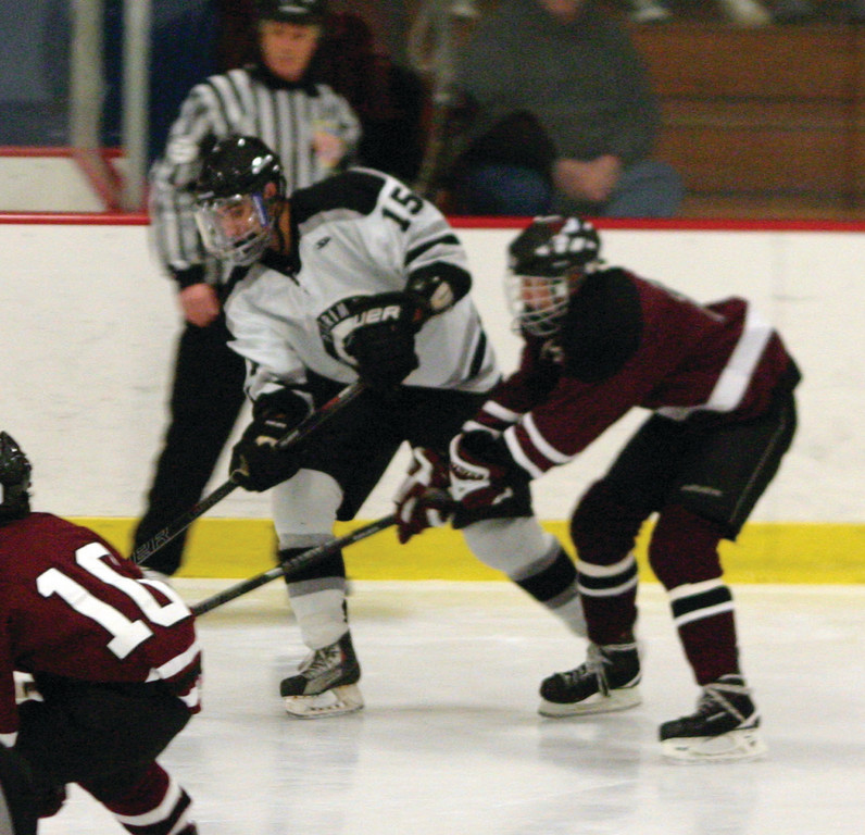 TIGHT QUARTERS: Taylor Stringfellow tries to hold on to the puck.