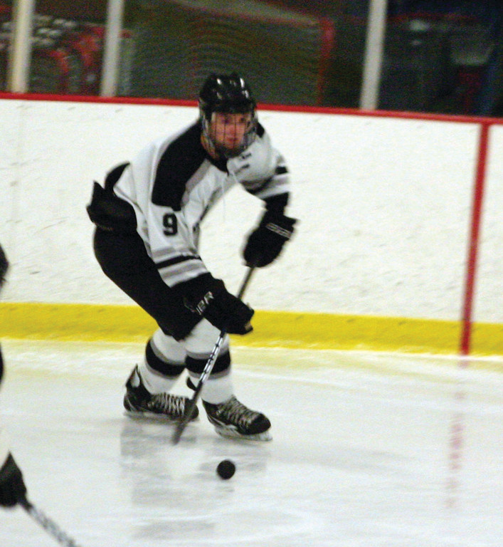 OFFENSE TO DEFENSE: Pilgrim's Cody Weaver skates through the neutral zone in Sunday's game.