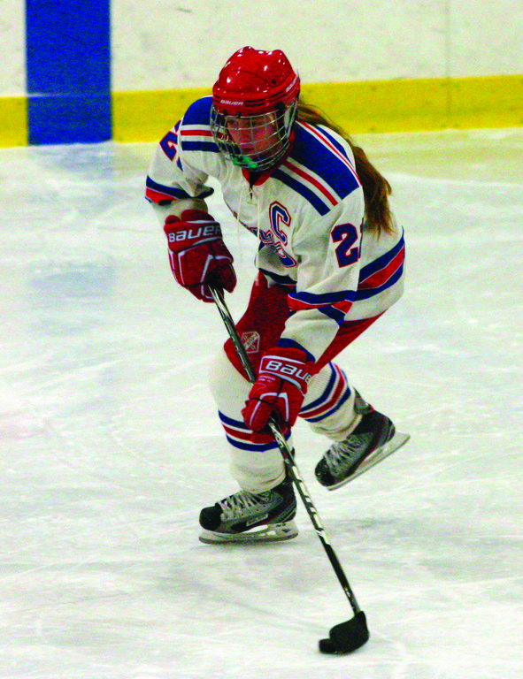 Jaime Claeson carries the puck.