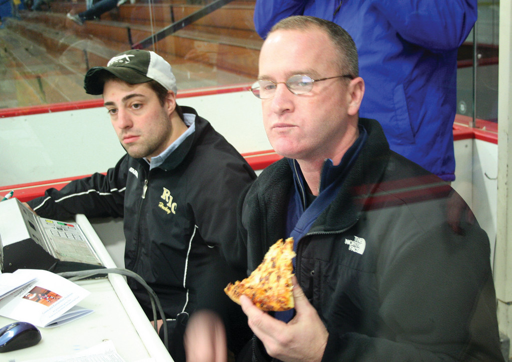 Volunteers Jack Adamo (left) and Darren Ellis keep an eye on the action from the scorers' booth.