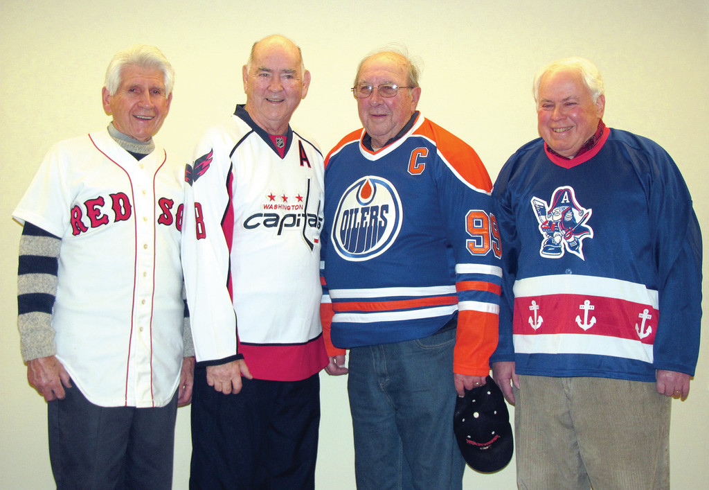 SPORTS FANATICS: Pictured from left are St. Joseph Men's Guild members Joe Shakedown, Jim Parker, Leroy DeCesare and John Murphy.