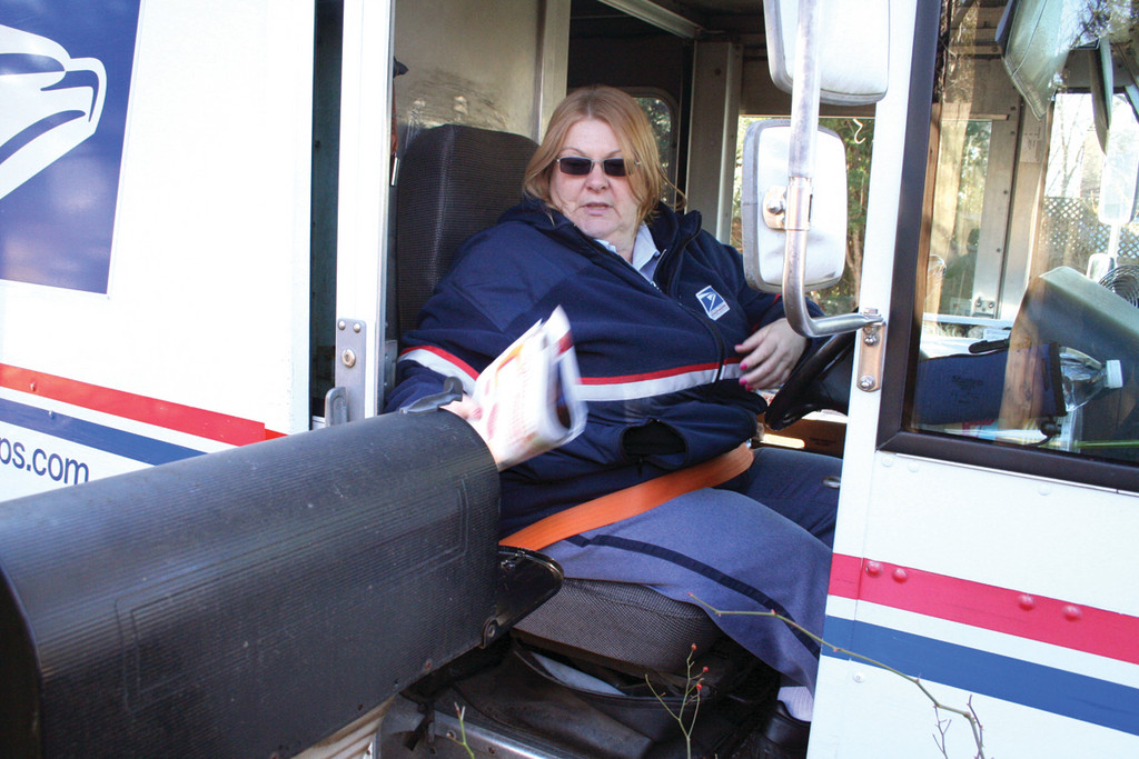 GETTING OUT THE MAIL: A 25-year Postal Service employee, Janet Lavoie says it takes her from nine to ten hours to complete her route of about 900 stops. She said people on their days off have had to be called in to cover routes and she doesn't know how carriers will cope with the job when about 15 temporary positions are to be eliminated in the near future.