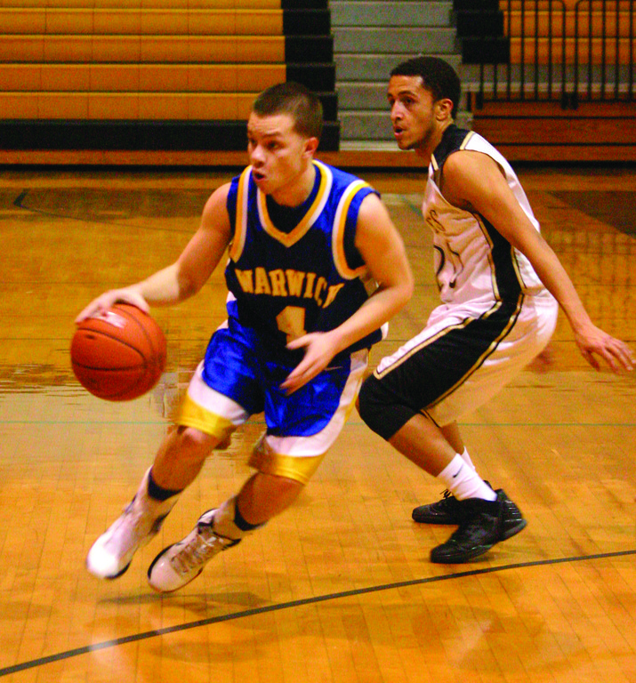 LOOK AWAY: Dom Malaga looks to the wing on his way to the basket during Tuesday's game at Davies.