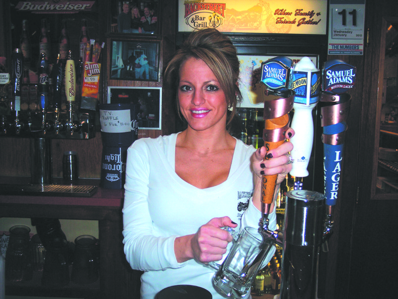 Bartender Kathleen pours up a thirst-quenching draft beer straight from the tap at Moranto's Backstreet Bar & Grill.