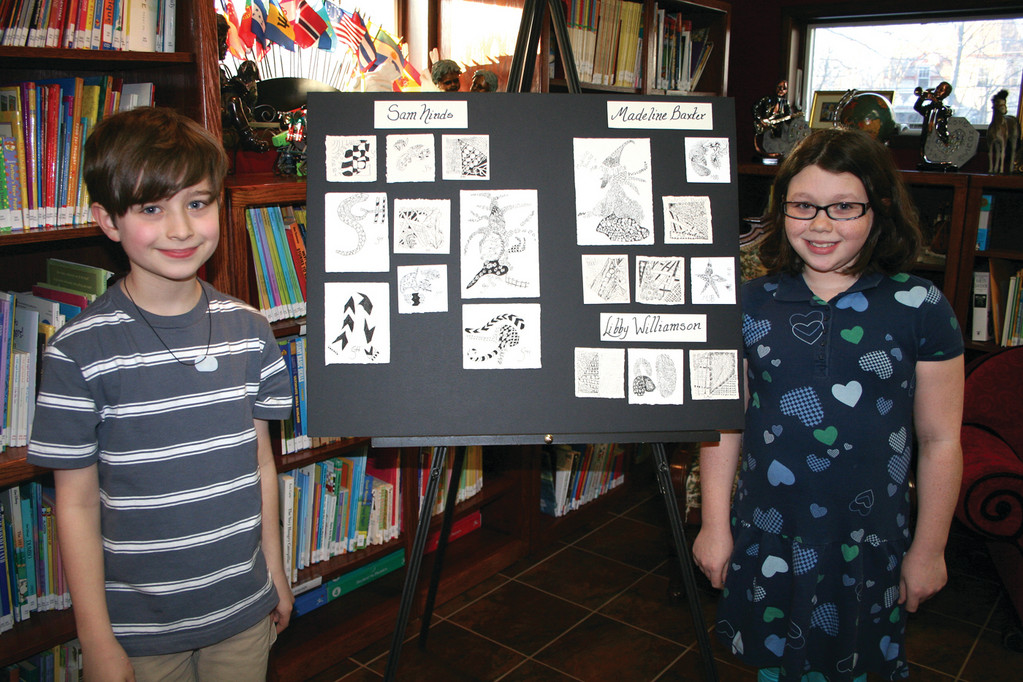 HIS AND HERS: Sam Ninds and Libby Williamson were among the students who signed up for the 15 weeks of Zentangle instruction at Carriage House. Their classmates, Aislinn and Madeline Baxter couldn't attend the show, but had their work on display as well.