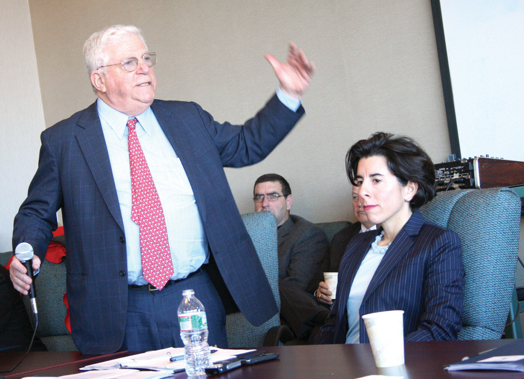 BITING THE BULLET: Former New York Lt. Governor Richard Ravitch offered an outsider's perspective at a pension workshop held Tuesday for cities and towns. Beside him is General Treasurer Gina Raimondo. Ravitch said everyone has to be willing to bite the bullet when it comes to municipal pensions and budgets.