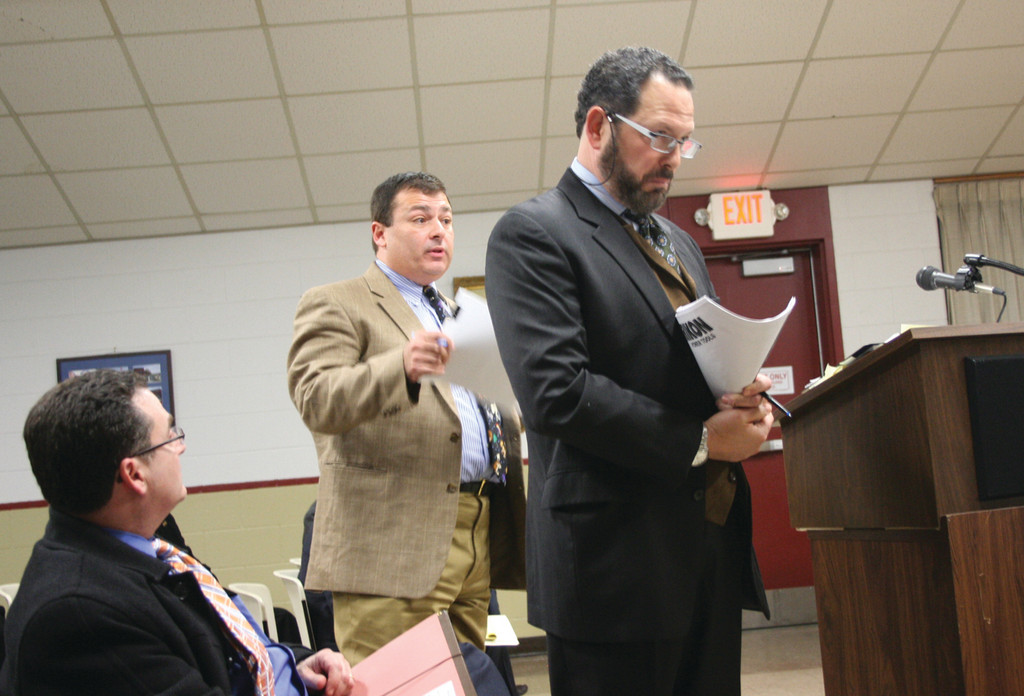 DUELING ATTONEYS: K. Joseph Shekarchi (left) who represented Chelo's, objects to a comment made by attorney Jeff Gladstone at Tuesday's Board of Public Safety meeting.