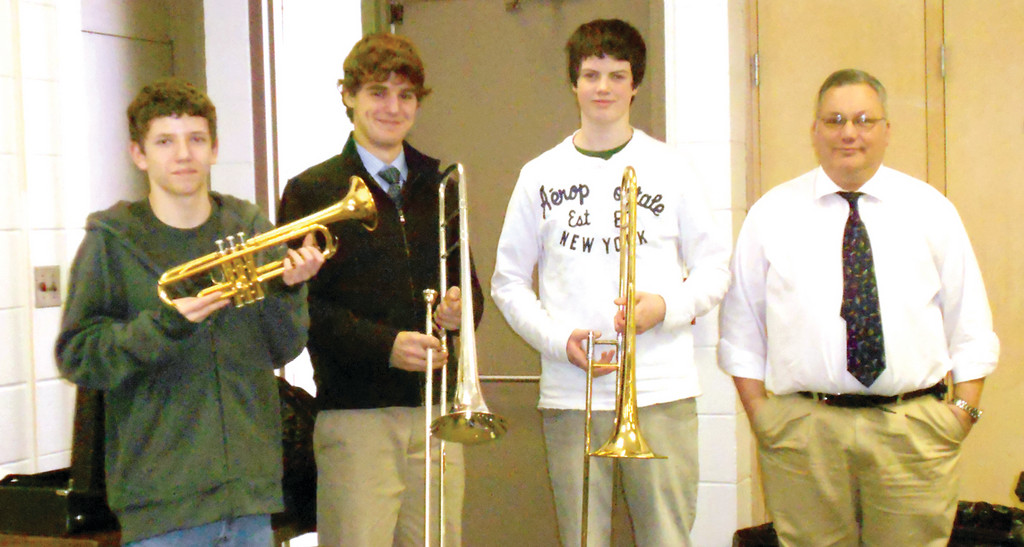 Teacher Christopher Pratt with students Duncan Sparfven, Sam Adamo, and Elijah Dressel.