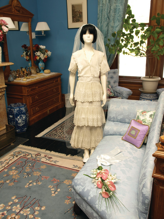 GORGEOUS GOWNS: The fourth annual 100 Years of Romance, a showcase of 20 wedding gowns and ceremonial memorabilia from 1880 to the 1990s, will be featured at Clouds Hill Victorian House Museum at 4157 Post Road on Feb. 12 and 19. Each decade will be represented in its own vignette in 12 of the 27 rooms of the historical house, including this gown from the 1920s.