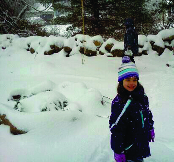 ALL BUNDLED UP: Lily Marcotte enjoys the snowy weather Saturday. These photos were uploaded to the Warwick Beacon Facebook page last weekend. �Like� the Beacon on Facebook for regular news updates and chances to have your photos and stories published in the newspaper.