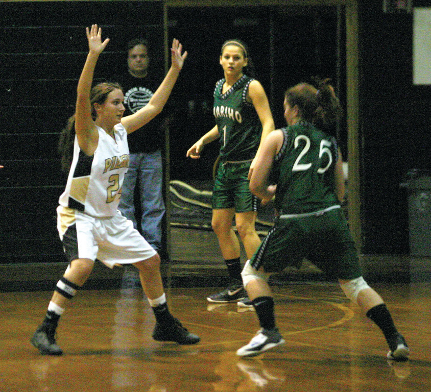 HANDS UP: Pilgrim's Guilia Garcia stays in front of Chariho's  Susanna Beil in Tuesday's game. The Pats stayed close but rebounding woes proved costly in a 59-46 loss.